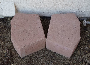 Bricks used to raise the rain barrel